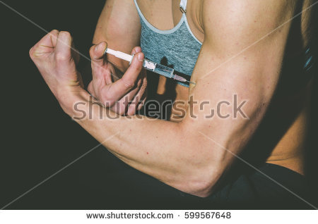 stock-photo-young-woman-inject-anabolic-steroids-doping-in-sport-concept-599567648